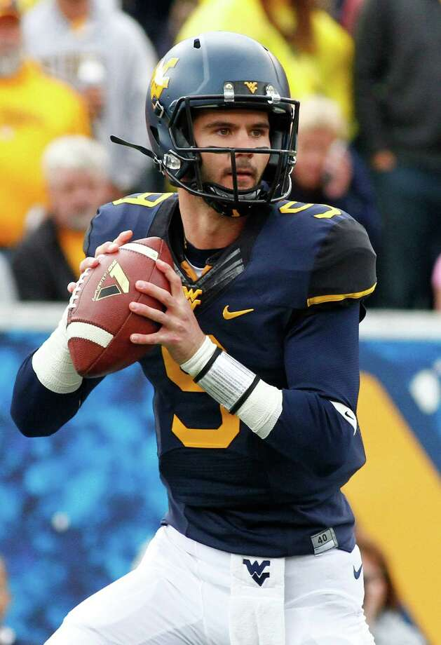MORGANTOWN, WV - OCTOBER 18:  Clint Trickett #9 of the West Virginia Mountaineers drops back to pass against the Baylor Bears during the game on October 18, 2014 at Mountaineer Field in Morgantown, West Virginia.  (Photo by Justin K. Aller/Getty Images) ORG XMIT: 513723785 Photo: Justin K. Aller / 2014 Getty Images