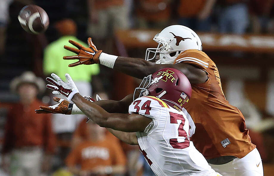 Longhorn receiver John Harris stretches to make a catch in front of Austin Fischer as Texas hosts Iowa State at Royal Memorial  Stadium on October 18, 2014. Photo: TOM REEL