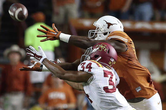 Longhorn receiver John Harris stretches to make a catch in front of Austin Fischer as Texas hosts Iowa State at Royal Memorial  Stadium on October 18, 2014.