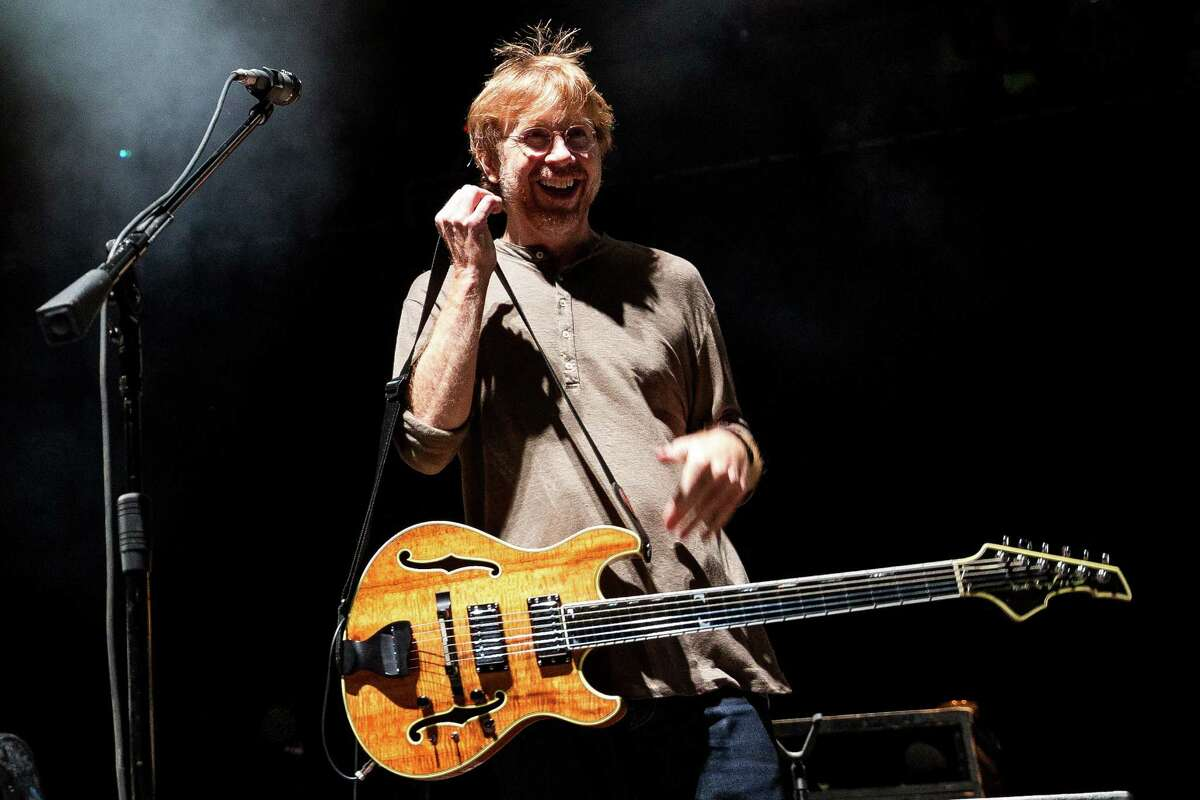 Trey Anastasio, lead singer and guitarist for American rock band Phish, performs live for thousands Saturday, October 18, 2014, at the KeyArena in Seattle, Washington.