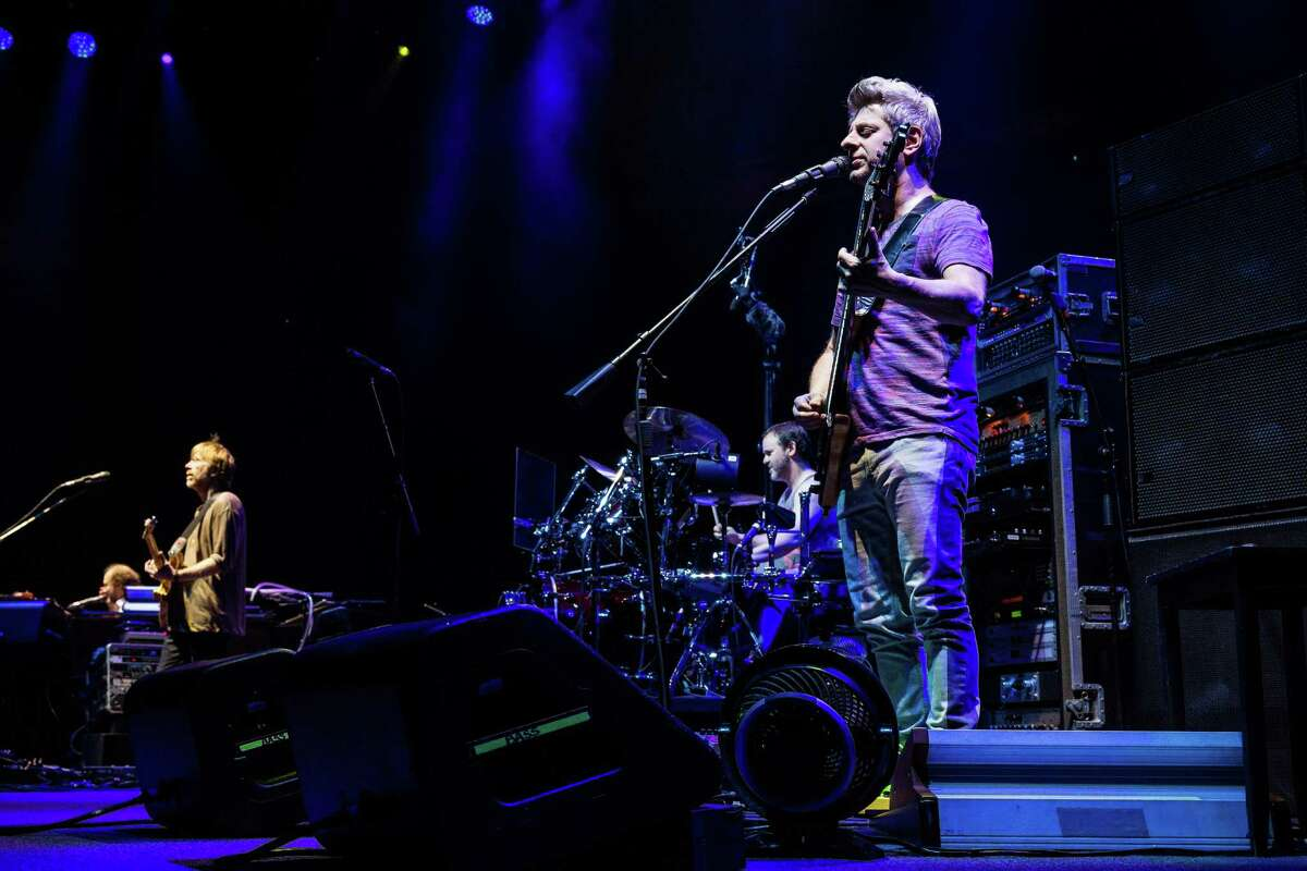 Mike Gordon, bassist for American rock band Phish, performs live for thousands Saturday, October 18, 2014, at the KeyArena in Seattle, Washington.