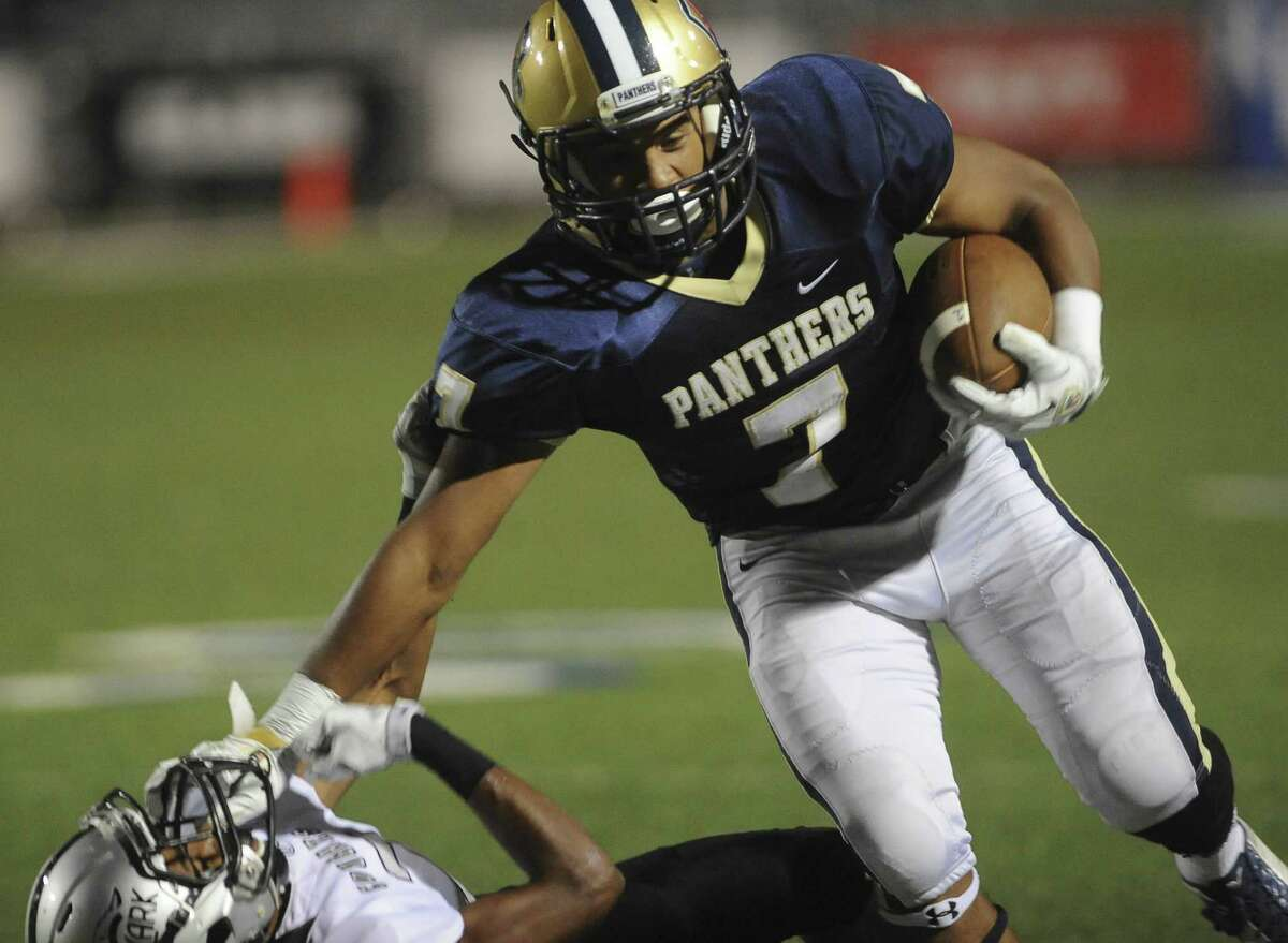 O'Connor running back Brandin Bradford stiff-arms Antonio De La Trigg of Clark as he churns for yardage during the Panthers' victory. Bradford had 82 yards rushing on eight carries.