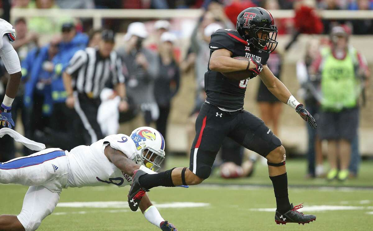 Texas Tech running back Justin Stockton, a former Steele High standout, breaks away from Kansas' Fish Smithson to score a 21-yard touchdown.