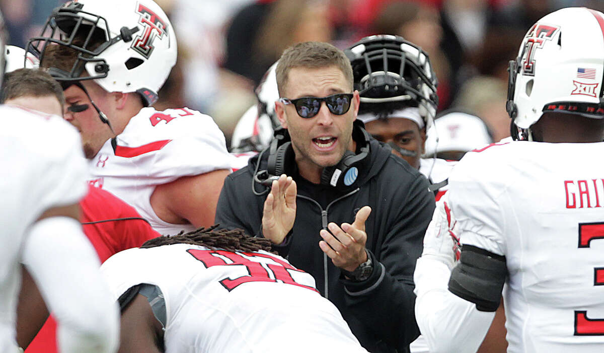 Texas Tech head coach Kliff Kingsbury claps during an NCAA college football game against West Virginia in Lubbock, Texas, Saturday, Oct. 11, 2014. (AP Photo/The Avalanche-Journal, Tori Eichberger) ALL LOCAL TV OUT