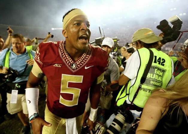 TALLAHASSEE, FL - OCTOBER 18:  Jameis Winston #5 of the Florida State Seminoles celebrates after defeating the Notre Dame Fighting Irish 31-27 at Doak Campbell Stadium on October 18, 2014 in Tallahassee, Florida.  (Photo by Streeter Lecka/Getty Images) ORG XMIT: 513461135 Photo: Streeter Lecka / 2014 Getty Images