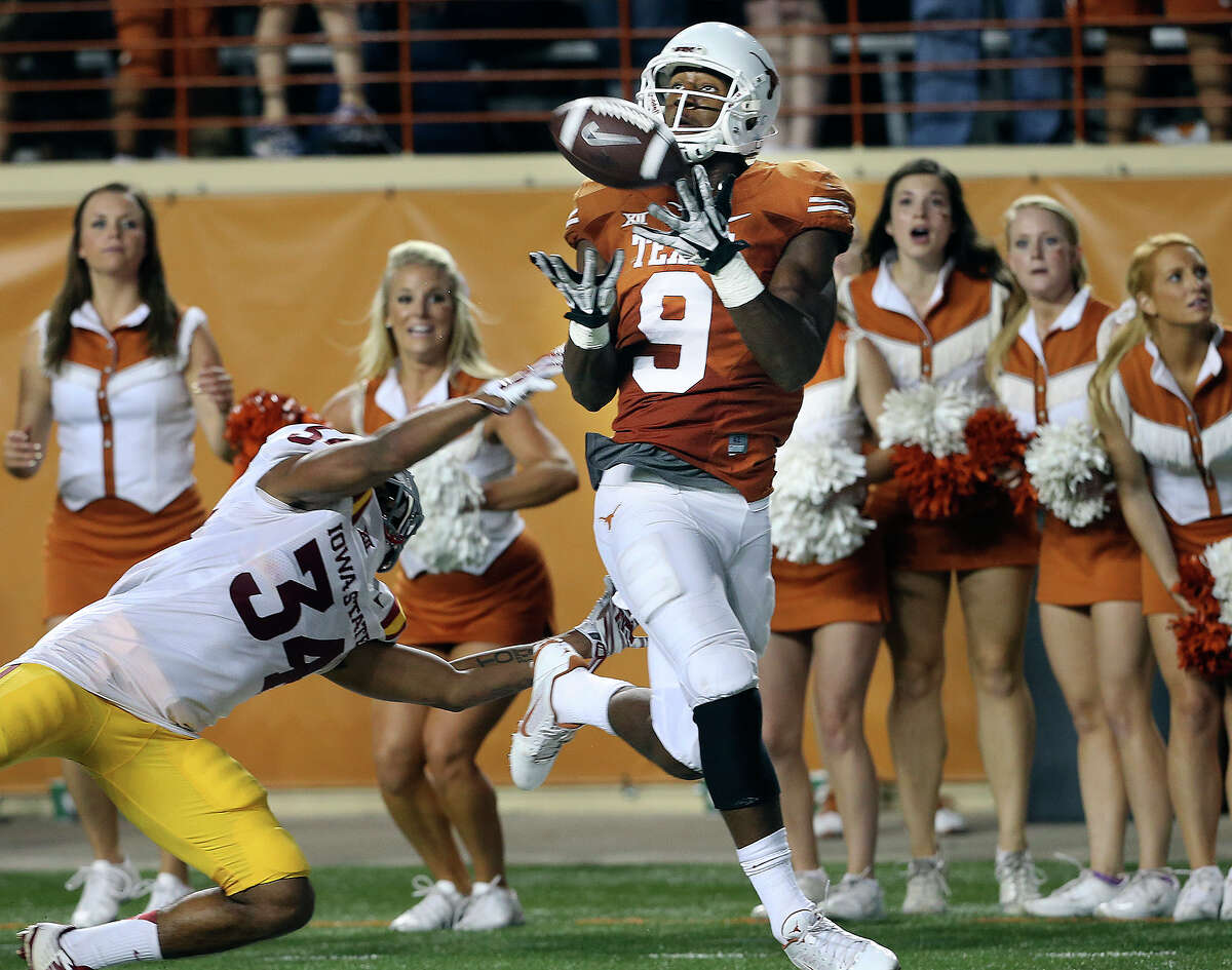 John Harris pulls in a 49 yard catch to set the winning score for the Longhorns as Texas beats Iowa State 48-45 at Royal Memorial Stadium on October 18, 2014.