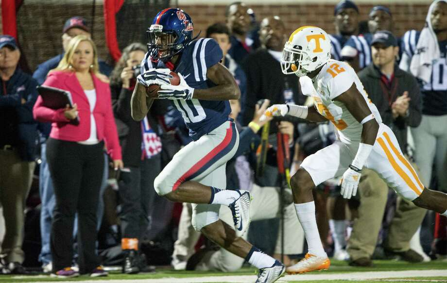 Mississippi wide receiver Vince Sanders runs down the sideline with Tennessee defensive back Emmanuel Moseley in pursuit during the first half of the Rebels' 34-3 SEC win Saturday night. Photo: Michael Chang / Getty Images / 2014 Getty Images