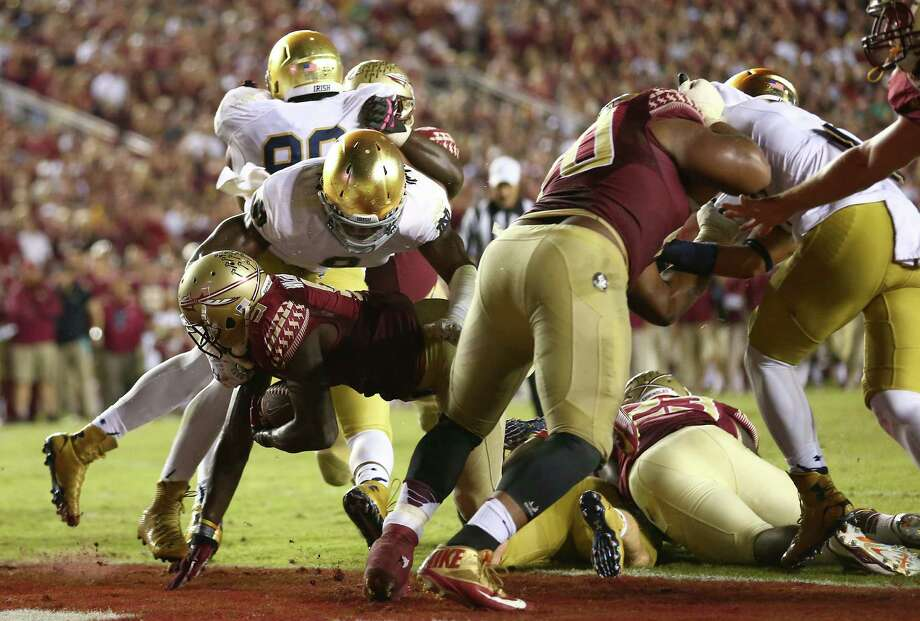 Florida State's Karlos Williams dives across the goal line midway through the fourth quarter against Notre Dame to put the Seminoles in the lead for good. Photo: Streeter Lecka / Getty Images / 2014 Getty Images