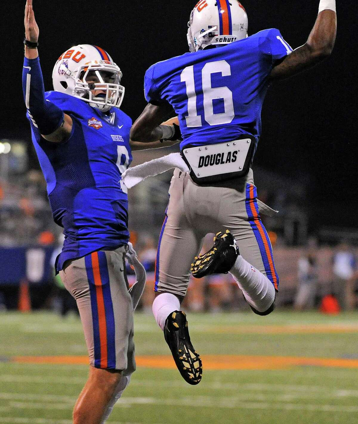 HBU wide receiver D'Angelo Wallace (16) celebrates his touchdown with quarterback Jonathan Fleming during the second half of a college football game against SFA, Saturday, October 18, 2014, at Husky Stadium in Houston.