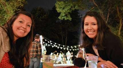 Lina Arbieto, left, and sister Lizbeth, both of Norwalk, at Saturday night's Earthplace Bonfire Bash.