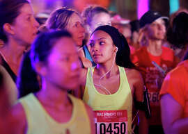Some of the more than 25,000 runners in the half-marathon gather before the race's start at 6:30 a.m. at Union Square.