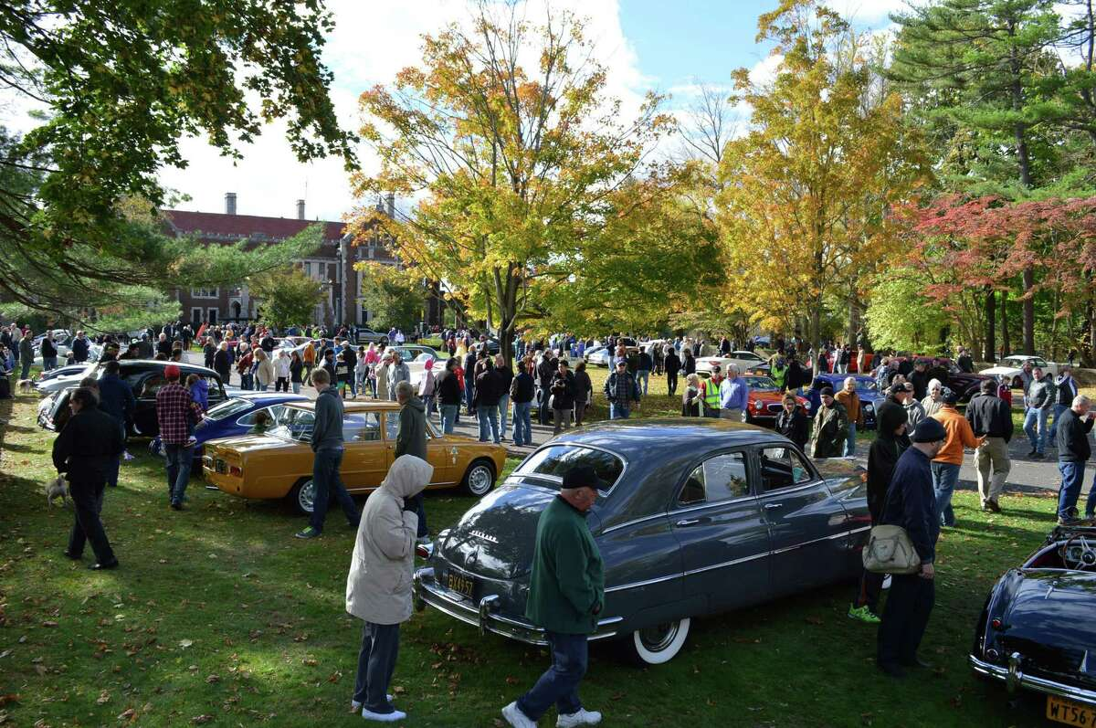 A large crowd turned out Sunday for the latest Caffeine $ Carburetors car show, which moved from downtown to Waveny Park for the first time.