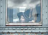 Medina Didio, 4, of Brookfiled, looks out the window of the Danbury Rail Museum Annual Pumpkin Patch Train on Sunday, October 19, 2014, in Danbury, Conn. Her mom Anila, Veizaj is behind her. Didio is dressed in a good witch costume for the event.