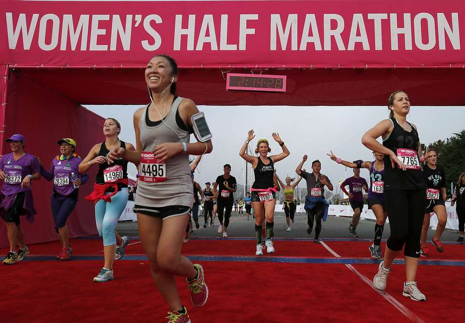 A view of the finish line crowded with runners Sunday October 19, 2014. The 11th annual Nike Women's Half Marathon, which celebrates female athletes in the Bay Area, started off from Union Square and ended at the Marina in San Francisco, Calif. Photo: Brant Ward, The Chronicle