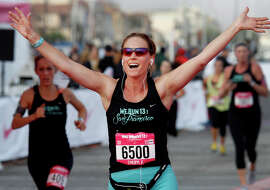 Cheryl Fletcher, from Seattle, raised her arms as she crossed the finish line of the 11th annual Nike Women's Half Marathon, which ended at Marina Green.