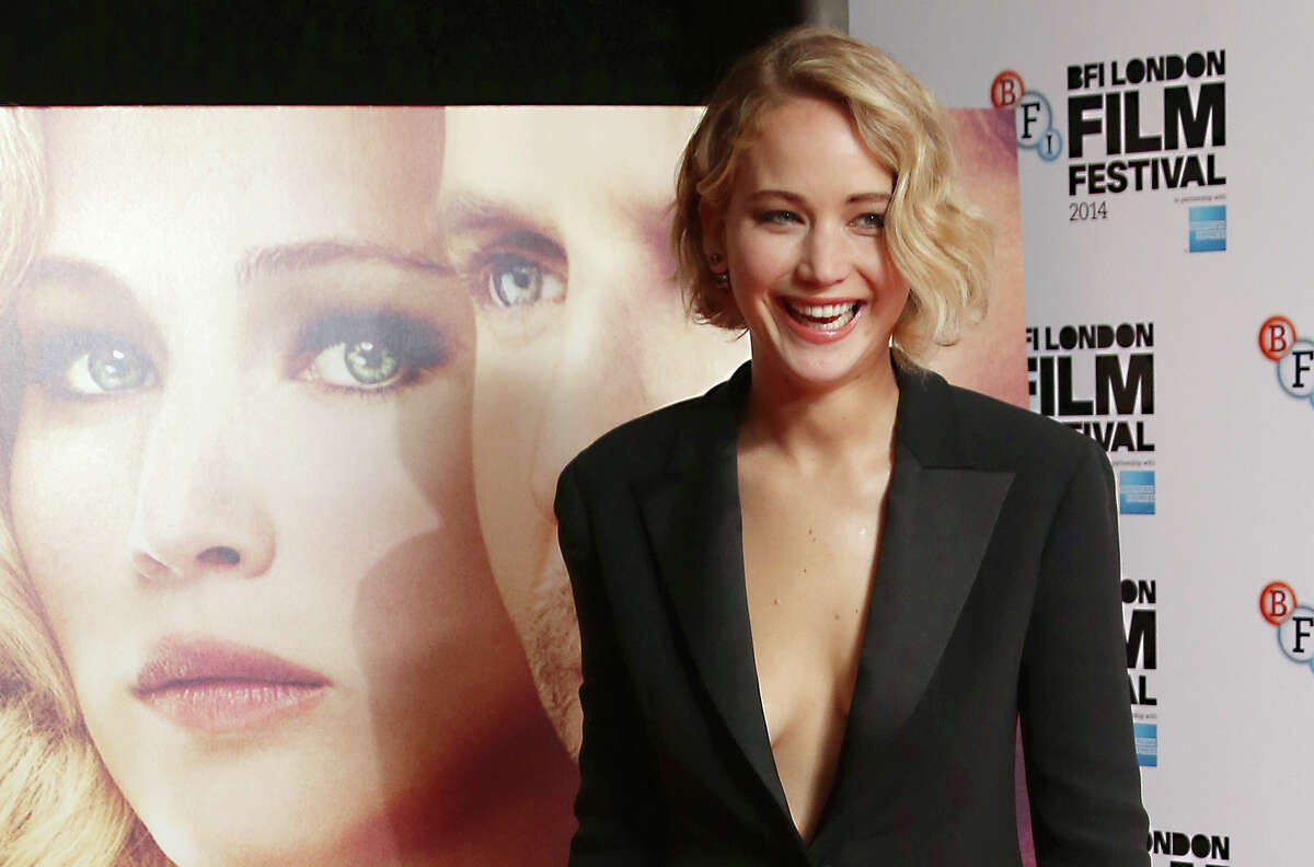 Actress Jennifer Lawrence poses for photographs during the photo call for the film Serena, as part of the BFI London Film Festival, at the Vue cinema in central London, Monday, Oct. 13, 2014.