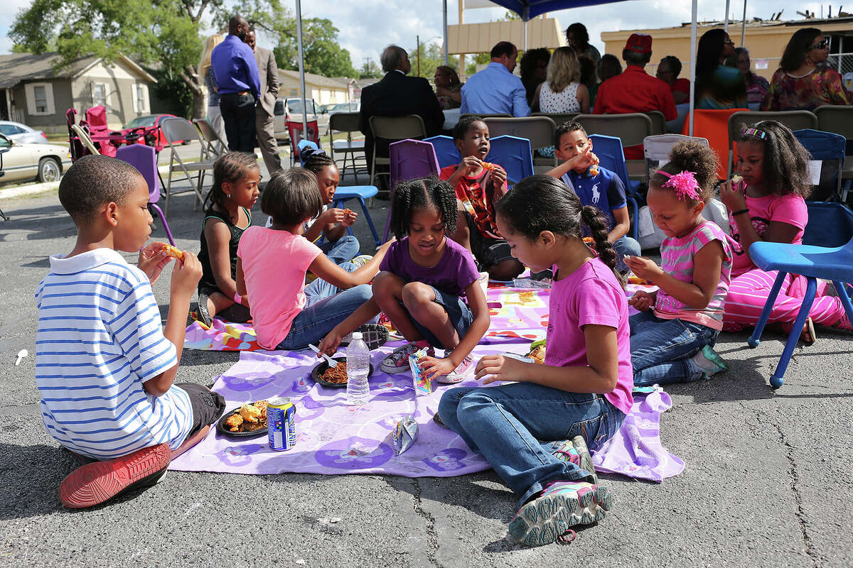 Children gather for a meal after a Healing Service at New Jerusalem Baptist Church, Sunday, Oct. 19, 2014. The service was held in the parking lot a week after the church building was destroyed in a fire on Monday.