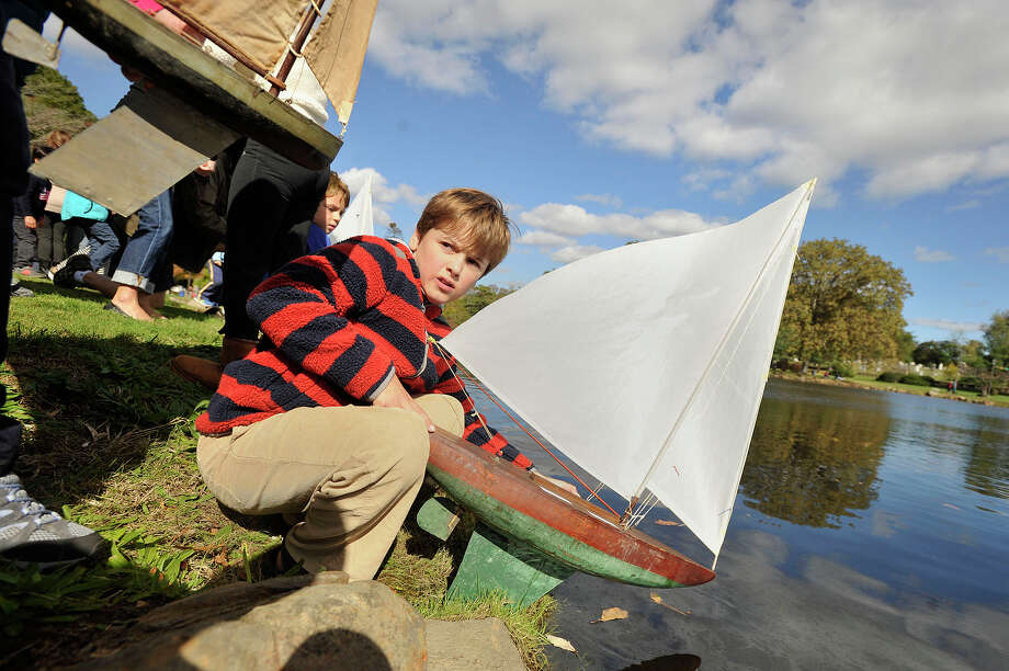 David Zelenz prepares to release his model sailboat for the first race of the day during the 51st annual Old Greenwich-Riverside Community Center Sailboat Regatta at Binney Park in Greenwich, Conn., on Sunday, Oct. 19, 2014. David and his sister, Marina, have been competing in the regatta for the past four years and race three boats. Photo: Jason Rearick / Stamford Advocate