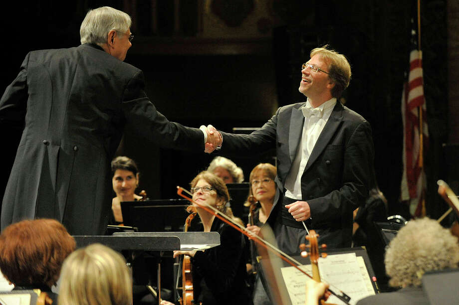 "Mayor David Martin greets conductor Eckart Preu after leading the Stamford Symphony orchestra in its rendition of the ""Star-Spangled Banner"" at the Palace Theatre in Stamford, Conn., on Sunday, Oct. 19, 2014. Photo: Jason Rearick / Stamford Advocate"