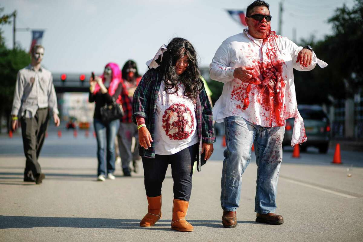 The zombie walk and costume parade outside of Minute Maid Park Saturday Oct. 19, 2014 in Houston.
