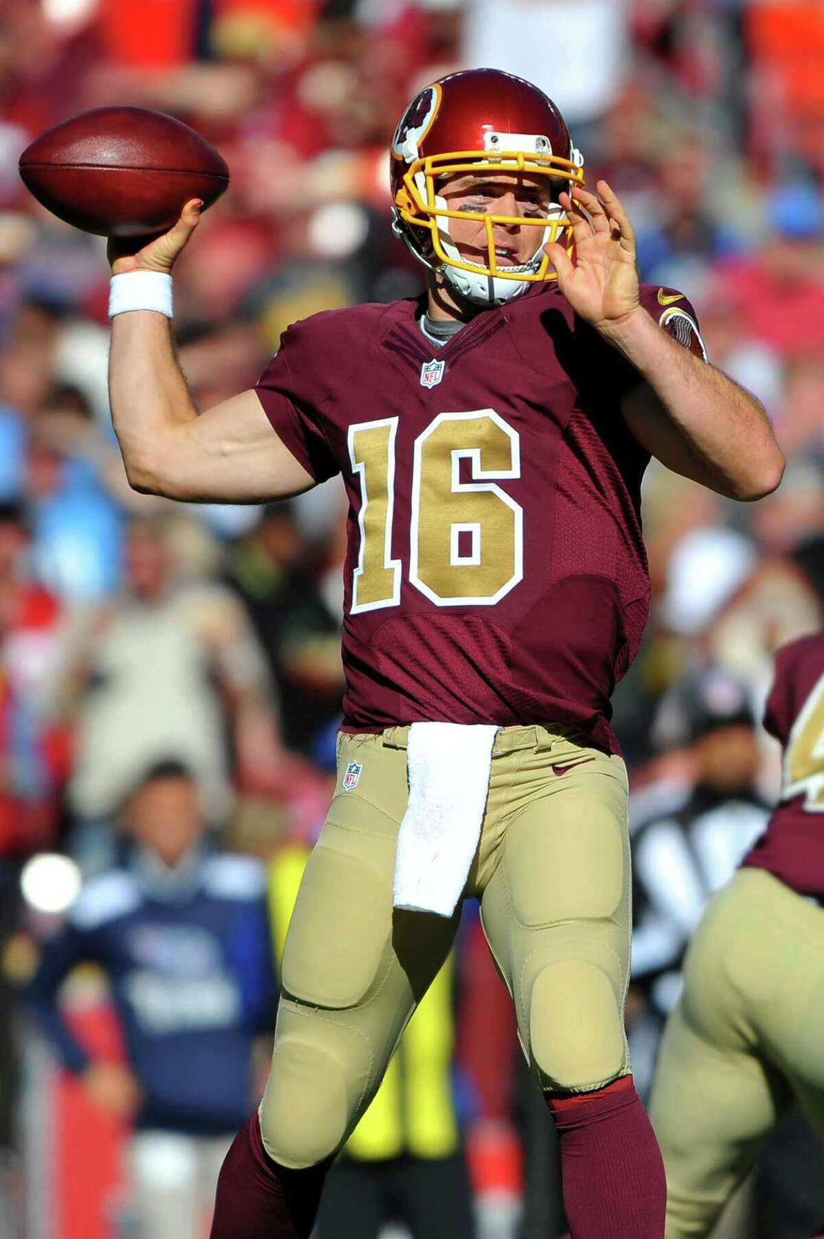 LANDOVER, MD - OCTOBER 19: Colt McCoy #16 of the Washington Redskins looks to pass against the Tennessee Titans during third quarter at FedEx Field on October 19, 2014 in Landover, Maryland.