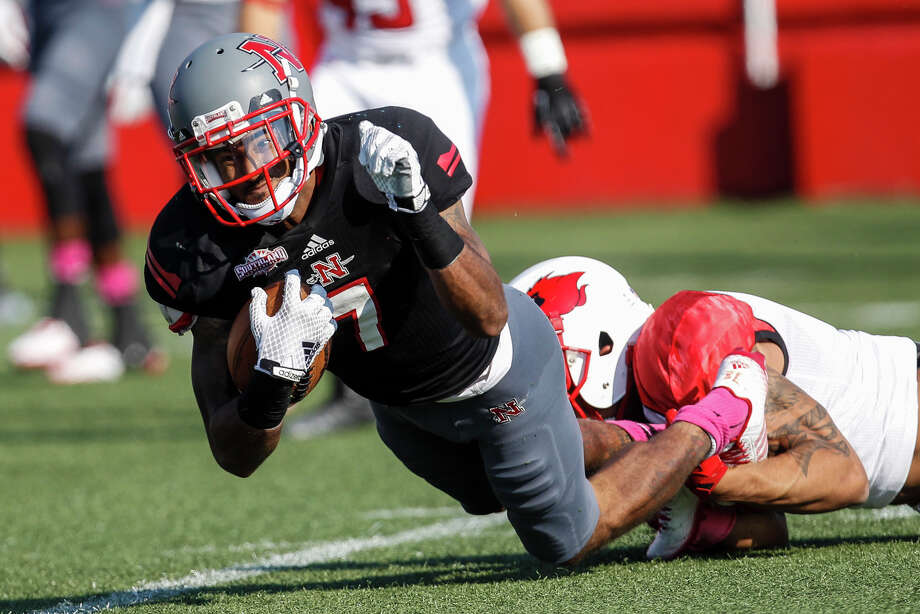 Nicholls State's Keenan Canty (7) gets tripped up by Lamar's Reggie Begelton (9) during a kick off return in Saturday's Southland Conference game at Manning Field in Thibodaux. Jim Cenac/Correspondent Photo: Jim Cenac, Correspondent