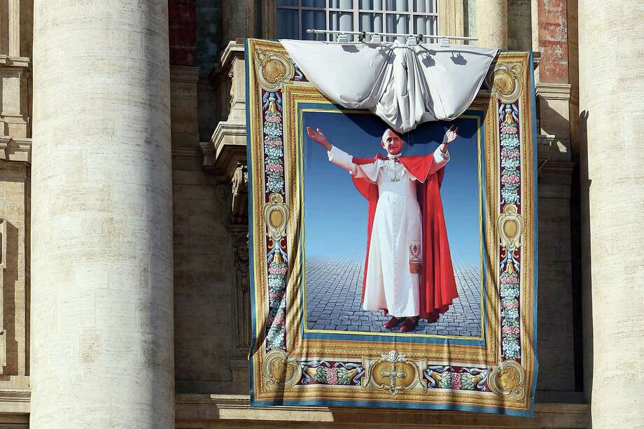 VATICAN CITY, VATICAN - OCTOBER 19:  A tapestry depicting Pope Paul VI is unveiled on the balcony of St Peters basilica during the holy mass for the closing of Extraordinary Synod held by Pope Francis on October 19, 2014 in Vatican City, Vatican. During the Mass  the Holy Father beatified his predecessor, Pope Paul VI, whom he described as a 'great Pope,' a 'courageous Christian' and a 'tireless apostle.  (Photo by Franco Origlia/Getty Images) Photo: Franco Origlia, Stringer / 2014 Getty Images