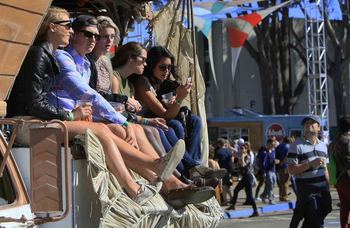 Festival-goers rest on top of a truck during the Treasure Island Music Festival on Treasure Island in San Francisco, Calif. Sunday, October 19, 2014