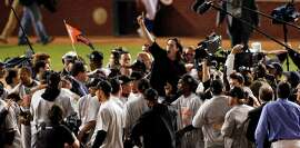 Caption Leadin Here: Winning pitcher, Tim Lincecum is lifted up on teammates shoulders as the Giants celebrate on the field after winning the final game of the World Series.The San Francisco Giants defeated the Texas Rangers 3-1 in Game 5 of the World Series at Rangers BallpWinning pitcher, Tim Lincecum is lifted up on teammates shoulders as the Giants celebrate on the field after winning the final game of the World Series.The San Francisco Giants defeated the Texas Rangers 3-1 in Game 5 of the World Series at Rangers Ballpark in Arlington, Tx, on Monday, November 1, 2010. Ran on: 11-02-2010 The Giants' Tim Lincecum gets a ride on teammates' shoulders after winning a pitchers duel with the Rangers' Cliff Lee for the world championship. Ran on: 11-02-2010 The Giants' Tim Lincecum gets a ride on teammates' shoulders after winning a pitchers' duel with the Rangers' Cliff Lee for the world championship. Ran on: 11-03-2010 Photo caption Dummy text goes here. Dummy text goes here. Dummy text goes here. Dummy text goes here. Dummy text goes here. Dummy text goes here. Dummy text goes here. Dummy text goes here.