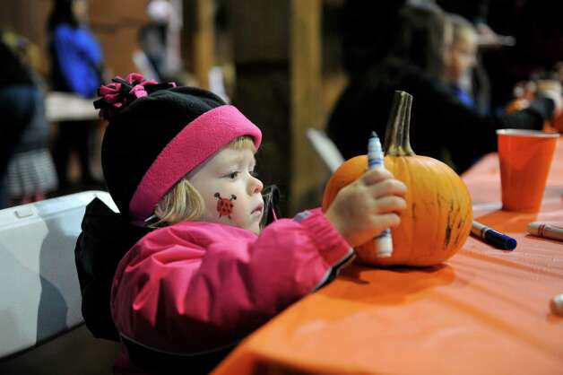 Ava Mossop, 2, from Latham works on decorating her pumpkin during the Fall Festival at the Pruyn House on Sunday, Oct. 19, 2014, in Latham, N.Y. The annual event is hosted by the The Greater Loudonville Association.   (Paul Buckowski / Times Union) Photo: Paul Buckowski / 00029047A