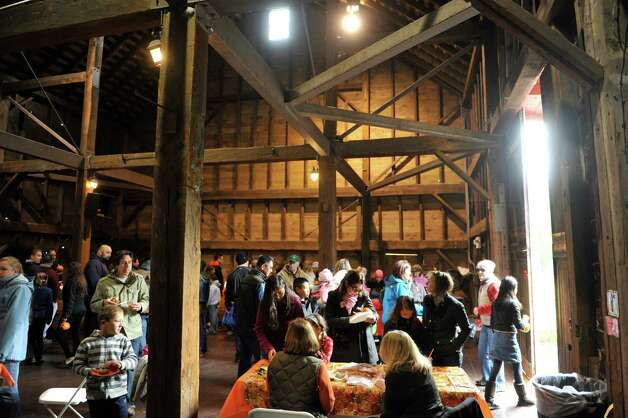 Families make their way around the Buhrmaster Barn  during the Fall Festival at the Pruyn House on Sunday, Oct. 19, 2014, in Latham, N.Y. The annual event is hosted by the The Greater Loudonville Association.   (Paul Buckowski / Times Union) Photo: Paul Buckowski / 00029047A