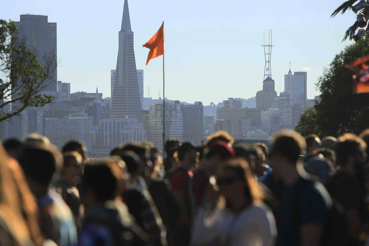 Crowds gather in front of the San Francisco skyline at the Treasure Island Music Festival on Treasure Island in San Francisco, Calif. Sunday, October 19, 2014