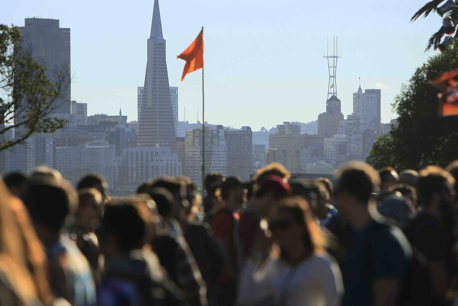 Crowds gather in front of the San Francisco skyline at the Treasure Island Music Festival on Treasure Island in San Francisco, Calif. Sunday, October 19, 2014 Photo: Jessica Christian, The Chronicle