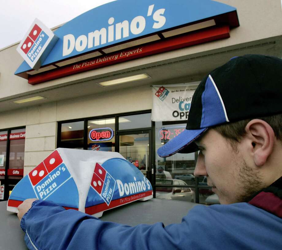 Domino's, which has 5,000 restaurants in the United States, has been delivering sales and profit figures lately that have impressed investors. Photo: Associated Press File Photo / AP