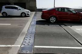 Traffic seems to slow near some steel plates stretching across all lanes Sunday October 19, 2014 in San Francisco, Calif. Steel plates installed on the west end of the Bay Bridge near the Fremont Street exit are bothering drivers who are slowing down.