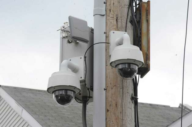 A pair of Schenectady Police street cameras affixed to a utility pole on Hamilton Street, across from Jerry Burell Park, between Paige and Schenectady Streets on Thursday March 20, 2014 in Schenectady, N.Y. (Michael P. Farrell/Times Union) Photo: Michael P. Farrell / 00026220A