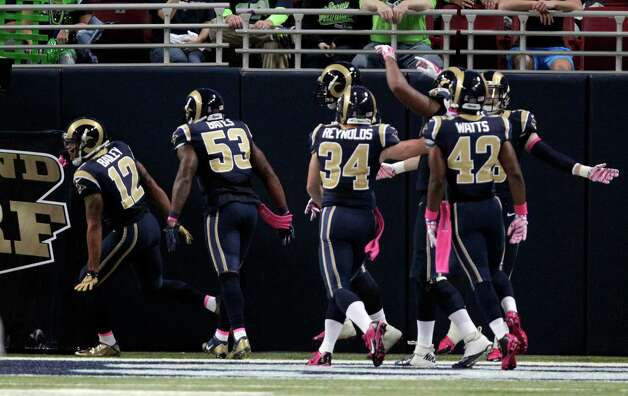 St. Louis Rams' Stedman Bailey, left, is congratulated by teammates after running a punt back 90 yards for a touchdown during the second quarter of an NFL football game against the Seattle Seahawks, Sunday, Oct. 19, 2014, in St. Louis. (AP Photo/Tom Gannam) ORG XMIT: MOJR112 Photo: Tom Gannam / FR45452 AP