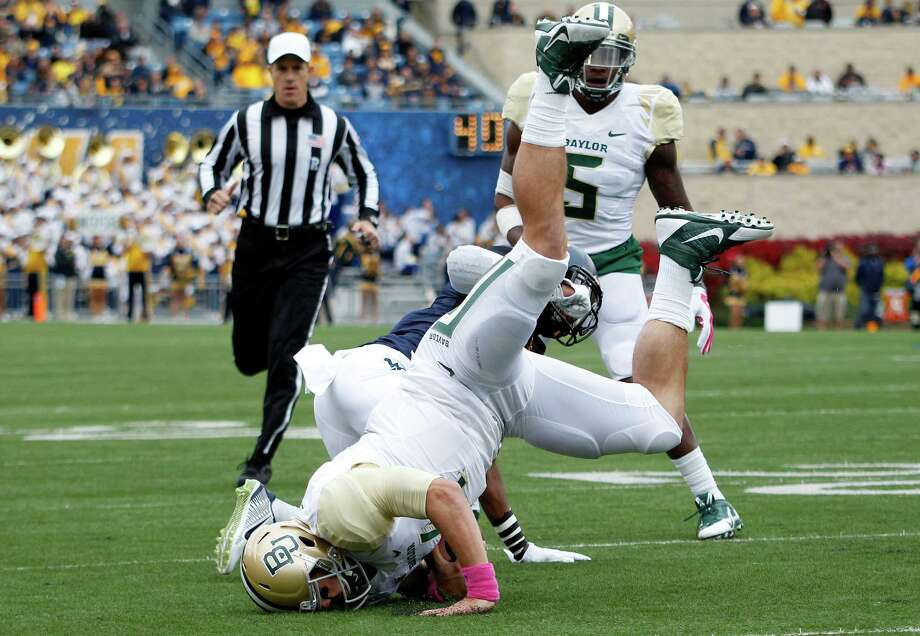 MORGANTOWN, WV - OCTOBER 18:  Bryce Petty #14 of the Baylor Bears rushes in the first half against the West Virginia Mountaineers during the game on October 18, 2014 at Mountaineer Field in Morgantown, West Virginia. Photo: Justin K. Aller, Getty Images / 2014 Getty Images