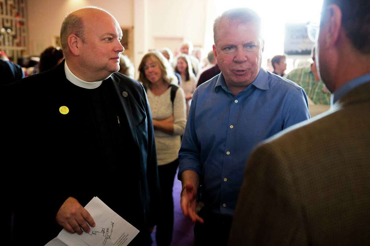 """Rev. Steve Thomason, dean of St. Mark's Cathedral, with Mayor Ed Murray. Says Thomason: """"If officials come into our place of worship seeking to extract people who are here peacefully, they will have to pass through a veritable wall of faithful citizens who decry such acts as evil, un-Christian and un-American.""""."""