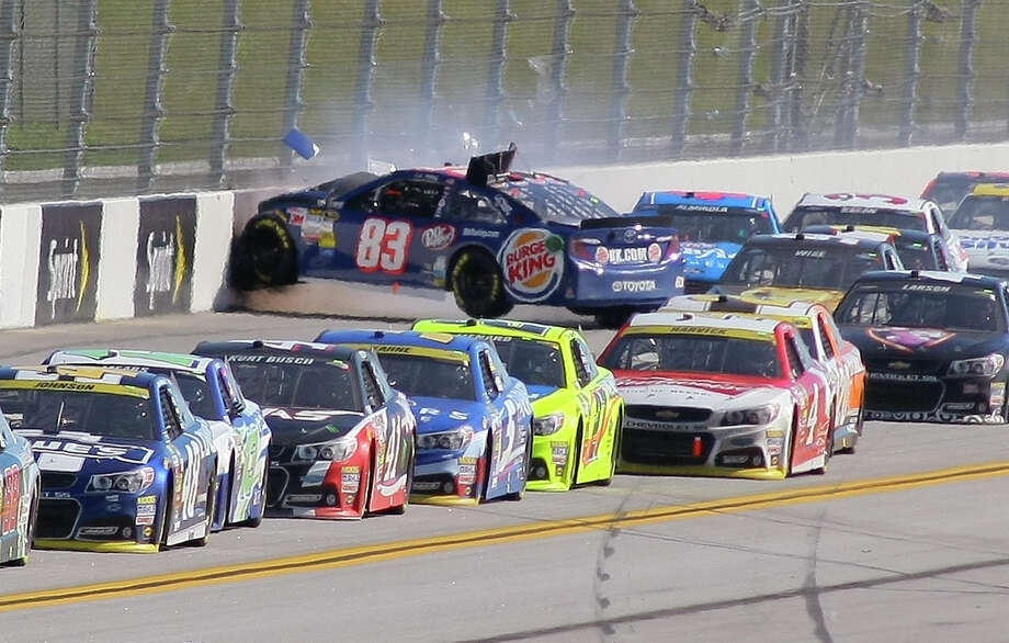J.J. Yeley (83) wrecks on the backstretch during the NASCAR Sprint Cup Series auto race at Talladega Superspeedway, Sunday, Oct. 19, 2014, in Talladega, Ala. (AP Photo/Greg McWilliams) ORG XMIT: ALJB119 Photo: Greg McWilliams / FR150231 AP
