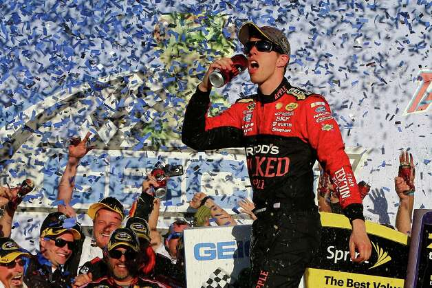 TALLADEGA, AL - OCTOBER 19:  Brad Keselowski, driver of the #2 Redd's Wicked Apple Ale Ford, celebrates in victory lane after winning the NASCAR Sprint Cup Series GEICO 500 at Talladega Superspeedway on October 19, 2014 in Talladega, Alabama.  (Photo by Jonathan Ferrey/Getty Images) ORG XMIT: 464041779 Photo: Jonathan Ferrey / 2014 Getty Images
