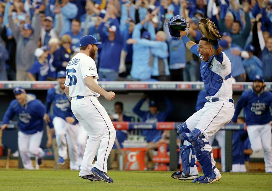 Kansas City Royals relief pitcher Greg Holland and catcher Salvador Perez celebrate after the Royals defeated the Baltimore Orioles 2-1 in Game 4 of the American League baseball championship series Wednesday, Oct. 15, 2014, in Kansas City, Mo. The Royals advance to the World Series. (AP Photo/Matt Slocum )  ORG XMIT: ALCS233 Photo: Matt Slocum / AP
