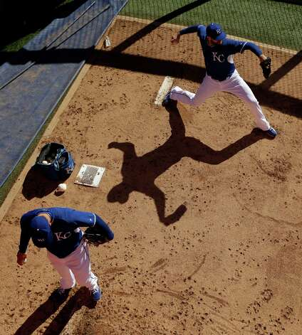 Kansas City Royals relief pitcher Wade Davis, right,, and starting pitcher James Shields throw in the bullpen during practice Saturday, Oct. 18, 2014, in Kansas City, Mo. The Royals will host the San Francisco Giants in Game 1 of the World Series on Oct. 21. (AP Photo/Charlie Riedel) ORG XMIT: MOCR109 Photo: Charlie Riedel / AP