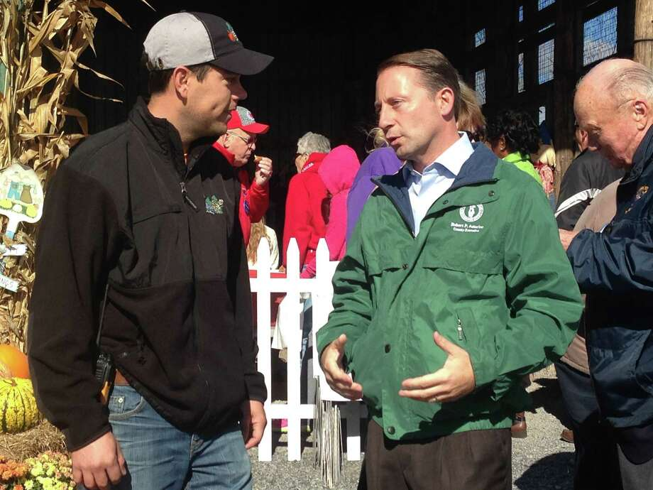 Republican gubernatorial candidate Rob Astorino speaks with an attendee of a town hall meeting at Ellms Family Farm in Ballston Spa on Sunday, Oct. 19, 2014. The town hall was part of Astorino's tour of the Capital Region.