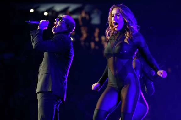 Singer Pitbull belts one out at Toyota Center.