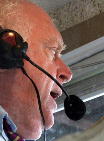 Retiring track announcer Tom Durkin calls the fourth race on the card Wednesday afternoon, Aug. 13,