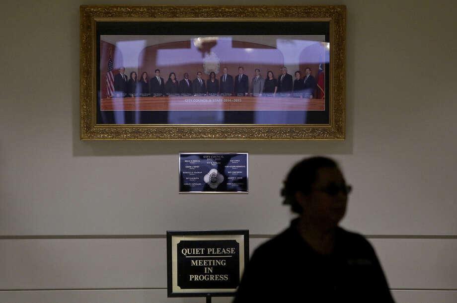 A panoramic portrait of the 11 City Council members hangs outside the City Council chambers in the Municipal Plaza Building. But Councilman Cris Medina isn't in the picture. Photo: Lisa Krantz / San Antonio Express-News / ©2014 San Antonio Express-News