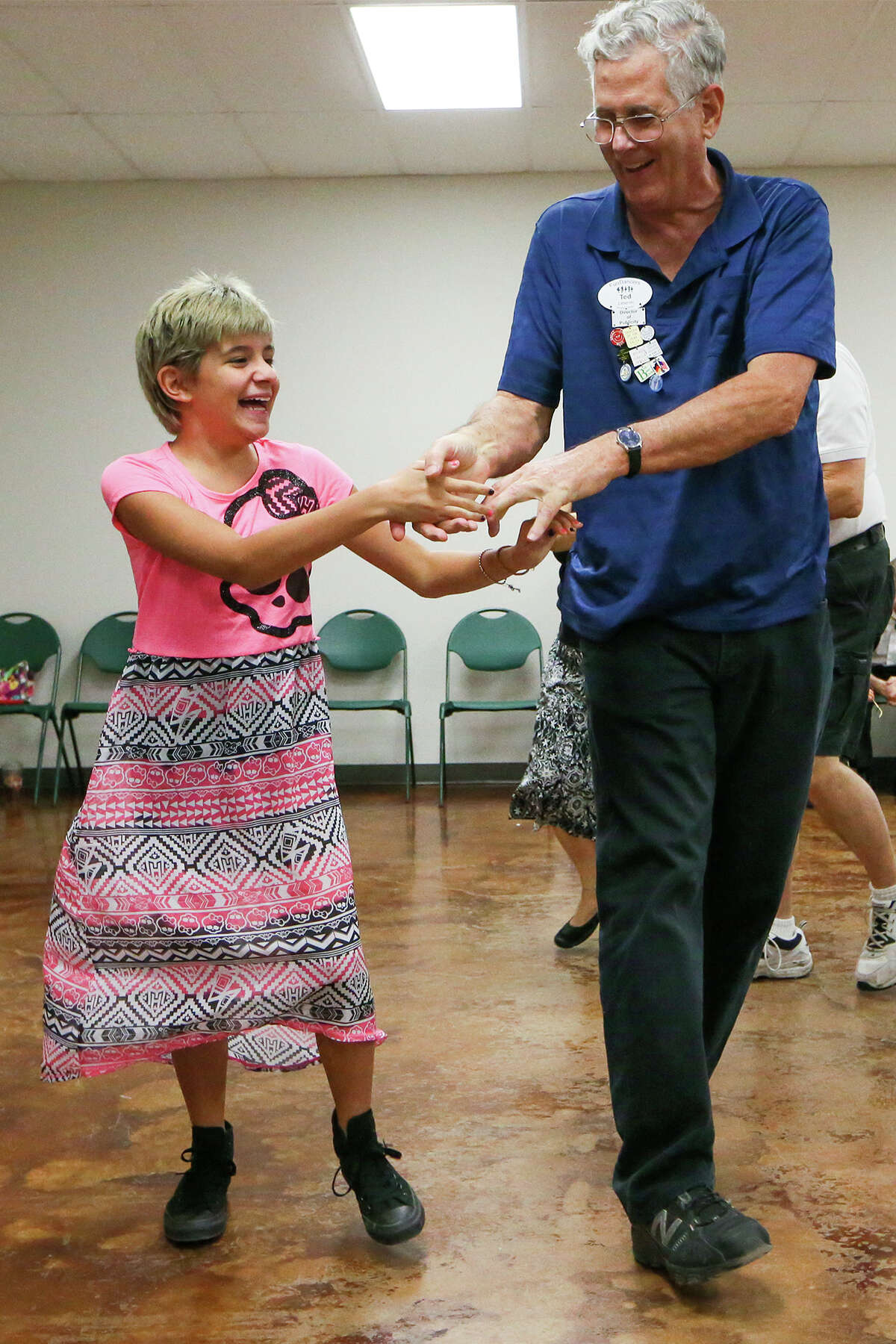 Twelve-year-old A.J. Kerr (left) dances with Ted Zahorski during the FunDancers' Square and Line Dancing Club dance at the Community Center North building in Schertz on Sunday, Sept. 7, 2014. MARVIN PFEIFFER/ mpfeiffer@express-news.net