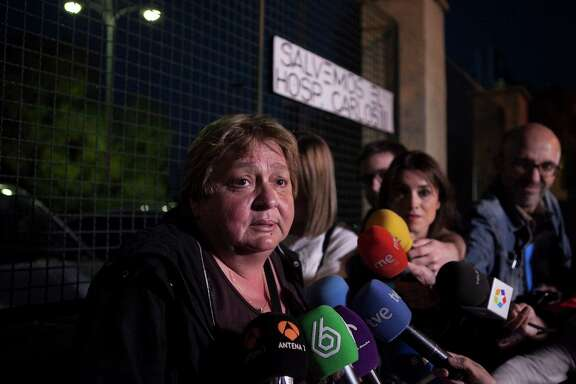 Teresa Mesa, left, spokesperson for Teresa Romero, speaks to the media in Madrid on Sunday after Spain said a test showed that Romero was clear of Ebola.
