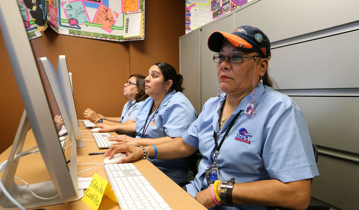 Erlinda Castillo (from right), Evangelina Rivera and Patricia Salazar work on their computer skills in a class taught by Ilna Colemere, senior program coordinator of the office of teacher education services at UTSA, where Castillo's request to learn how to use a computer prompted the creation of Erlinda's Wish.